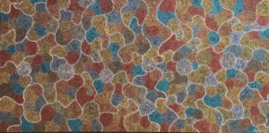 Title: Trace Elements                                                                          - Artist: Greg Matthews                                                                                      (2018 -  Storm water meanders its way down irregular tracks, eventually finding its way to the dry Australian water holes. The steady flow of water over the parched earth creates a force that erodes and exposes the beautiful colours of the natural elements and minerals.)