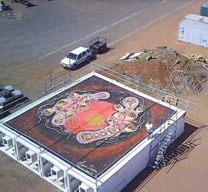 Title: Platypus Mating                                                                          - Artist: Lewis Burns                                                                                      (2018 - 12m x 12m mural on the side of 4 square silos. This artwork was commissioned by ARAN Continuous Mixing & Slip Formed Concrete. The Silos were built in China and delivered to Dubbo on the way to their final destination (A mine near Cobar NSW). They were send to Dubbo so I could do the mural work on them while they are laying down.)