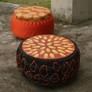 Title: SeaSIDE Table & SeaSIDE Ottoman                                                                          - Artist: Francoise Lane                                                                                      (2016 I wanted to create something functional and beautiful with sensitivity to the environment. A sculptural furniture piece that made from recycled timber, fish netting and tyres. The table top is painted in Fingers pattern (an element of Coral Floral design) and Ottoman is upholstered in Fingers eco canvas.)